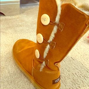 Brown Ugg boots with beige buttons